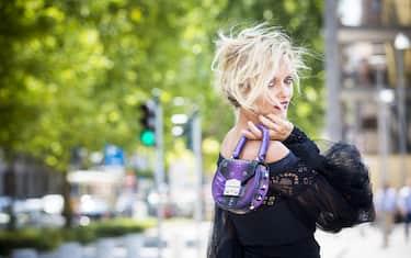 MILAN, ITALY - JULY 10:  Justine Mattera wears Chiara Boni jumpsuit and Salar Milano bag on July 10, 2017 in Milan, Italy.  (Photo by Claudio Lavenia/GC Images)