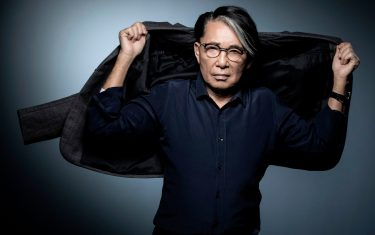 Japanese-French fashion designer Kenzo Takada poses during a photo session in Paris on November 14, 2018. (Photo by JOEL SAGET / AFP)        (Photo credit should read JOEL SAGET/AFP via Getty Images)