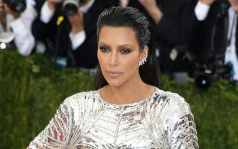 epa05567669 (FILE) A file photograph showing US television personality Kim Kardashian arriving on the red carpet for the 2016 Costume Institute Benefit at The Metropolitan Museum of Art in New York, New York, USA, 02 May 2016. Reports on 03 October 2016 state that Kim Kardashian has been held at gunpoint and robbed of jewellery in her Paris hotel room.  Her husband US musician Kanye West stopped his concert in New York on hearing the news.  EPA/JUSTIN LANE