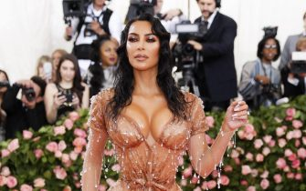 epa07554649 Kim Kardashian poses on the red carpet for the 2019 Met Gala, the annual benefit for the Metropolitian Museum of Art's Costume Institute, in New York, New York, USA, 06 May 2019 (issued 07 May 2019). The event coincides with the Met Costume Institute's new spring 2019 exhibition, 'Camp: Notes on Fashion', which runs from 09 May until 08 September 2019.  EPA/JUSTIN LANE