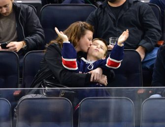 NEW YORK, NY - NOVEMBER 01:  Linda Evangelista and son Augustin James Evangelista attend New York Rangers vs Winnipeg Jets at Madison Square Garden on November 1, 2014 in New York City.  (Photo by James Devaney/GC Images)