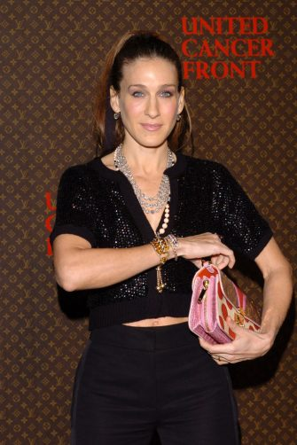 Sarah Jessica Parker with Louis Vuitton hand bag (Photo by Lester Cohen/WireImage)