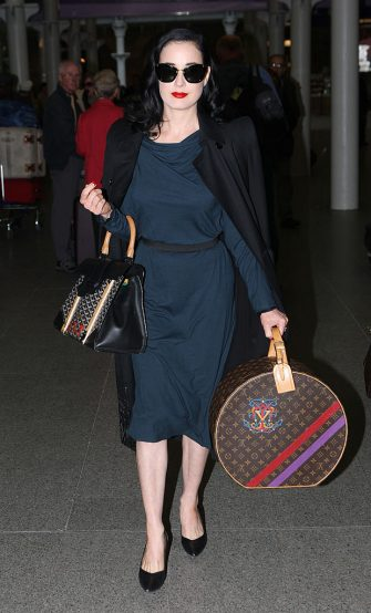 LONDON, UNITED KINGDOM - APRIL 30: Dita Von Teese seen arriving from Paris on April 30, 2012 in London, England. (Photo by Alex Moss/FilmMagic)