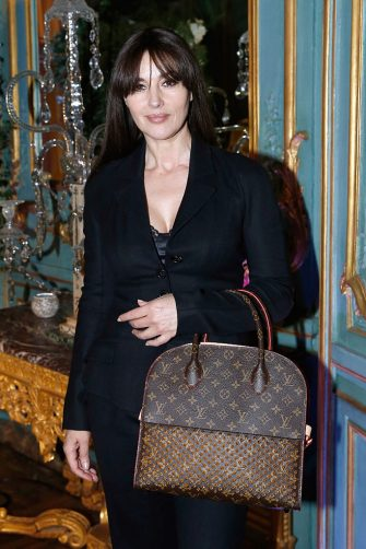 """PARIS, FRANCE - MARCH 03:  Actress Monica Bellucci, dressed in Dior with Bag Louis Vuitton, attends the """"International Women's Day Luncheon in Support of Equality and Safety for All"""" hosted by Swarovski as part of the Paris Fashion Week Womenswear Fall/Winter 2016/2017. Held at the Residence of US Ambassador to France on March 3, 2016 in Paris, France.  (Photo by Bertrand Rindoff Petroff/Getty Images)"""