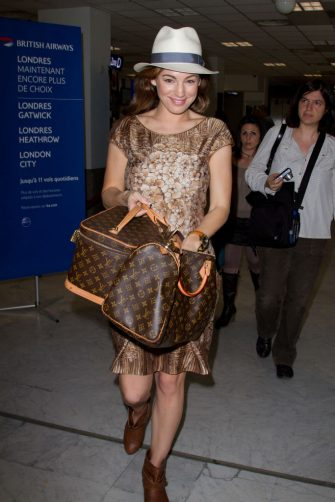 CANNES, FRANCE - MAY 25:  **EXCLUSIVE COVERAGE** Kelly Brook is seen at Nice airport on May 25, 2012 in Nice, France.  (Photo by Marc Piasecki/FilmMagic)