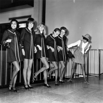 18th March 1968:  English fashion designer Mary Quant with a group of models at Heathrow Airport, before leaving for a continental fashion tour.  (Photo by Express/Express/Getty Images)