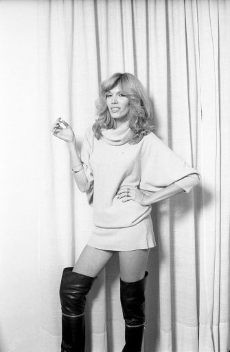 Actress and presenter Amanda Lear wearing boots and a miniskirt. 1977. (Photo by Adriano Alecchi/Mondadori via Getty Images)