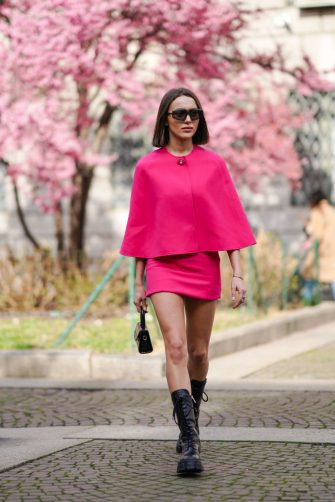 MILAN, ITALY - FEBRUARY 20: Mary Leest wears sunglasses, a pink cape/top, a skirt, a bag, outside Koche x Pucci, during Milan Fashion Week Fall/Winter 2020-2021 on February 20, 2020 in Milan, Italy. (Photo by Edward Berthelot/Getty Images)