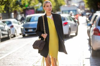 MILAN, ITALY - SEPTEMBER 26: Leonie Hanne seen wearing yellow dress with fringes, black blazer, bag, heels outside Ports 1961 during the Milan Women's Fashion Week on September 26, 2020 in Milan, Italy. (Photo by Christian Vierig/Getty Images)