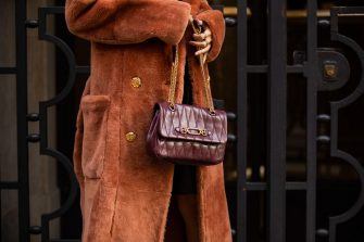 MILAN, ITALY - SEPTEMBER 26: Leonie Hanne seen wearing bordeaux bag and boots, coat outside Bally during the Milan Women's Fashion Week on September 26, 2020 in Milan, Italy. (Photo by Christian Vierig/Getty Images)