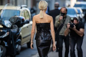 MILAN, ITALY - SEPTEMBER 27: Caroline Caro Daur seen wearing black off shoulder top, black pencil skirt outside Valentino during the Milan Women's Fashion Week on September 27, 2020 in Milan, Italy. (Photo by Christian Vierig/Getty Images)