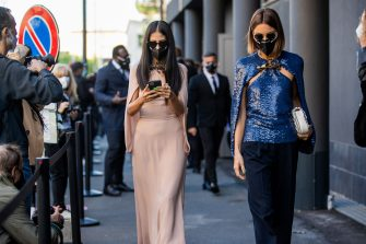 MILAN, ITALY - SEPTEMBER 27: Gilda Ambrosio seen wearing dress and Giorgia Tordini wearing blue top, navy pants outside Valentino during the Milan Women's Fashion Week on September 27, 2020 in Milan, Italy. (Photo by Christian Vierig/Getty Images)