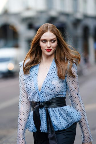 MILAN, ITALY - FEBRUARY 22: Larsen Thompson wears a blue low-neck mesh ruffled top, a belt, black pants, outside Philosophy, during Milan Fashion Week Fall/Winter 2020-2021 on February 22, 2020 in Milan, Italy. (Photo by Edward Berthelot/Getty Images)