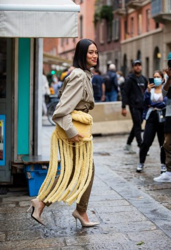 MILAN, ITALY - SEPTEMBER 24: Tiffany Hsu is seen wearing khaki pants, yellow bag with fringes outside Max Mara during the Milan Women's Fashion Week on September 24, 2020 in Milan, Italy. (Photo by Christian Vierig/Getty Images)