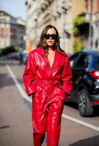 MILAN, ITALY - SEPTEMBER 26: Evangelie Smyrniotaki seen wearing red overall outside Philosophy during the Milan Women's Fashion Week on September 26, 2020 in Milan, Italy. (Photo by Christian Vierig/Getty Images)