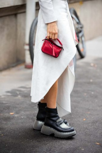 PARIS, FRANCE - OCTOBER 01: Caroline Caro Daur seen wearing red Loewe micro bag outside Loewe during Paris Fashion Week - Womenswear Spring Summer 2022 on October 01, 2021 in Paris, France. (Photo by Christian Vierig/Getty Images)
