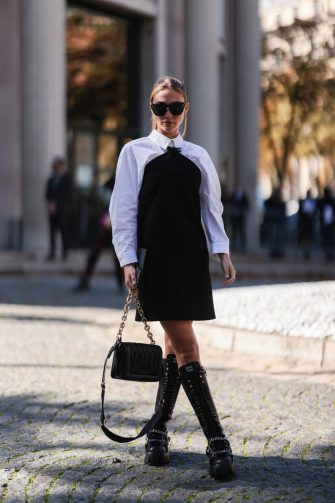 PARIS, FRANCE - OCTOBER 05: Ann Kathrin Götze wearing a white blouse, a black dress and black boots and a black bag outside Miu Miu Show on October 05, 2021 in Paris, France. (Photo by Jeremy Moeller/Getty Images)