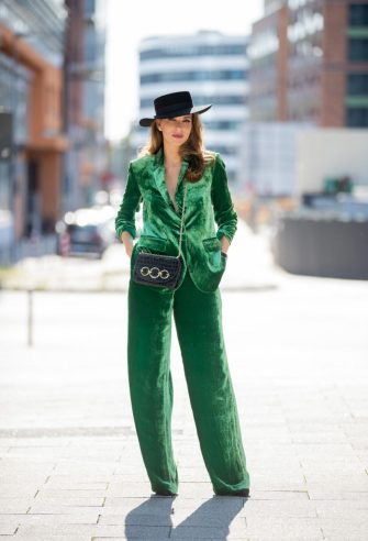 DUSSELDORF, GERMANY - SEPTEMBER 18: (EDITORS NOTE: Image has been digitally enhanced.) Alexandra Lapp is seen wearing green velvet suit Marc Cain, Marc Cain bag, Marc Cain heels, hat Marc Cain on September 18, 2020 in Dusseldorf, Germany. (Photo by Christian Vierig/Getty Images for Marc Cain)