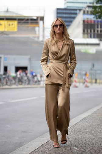 BERLIN, GERMANY - JULY 05: Karolina Kurkova is seen on the street during Berlin Fashion Week wearing copper silk outfit on July 05, 2019 in Berlin, Germany. (Photo by Matthew Sperzel/Getty Images)