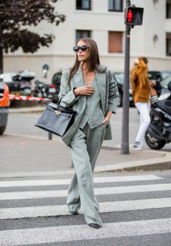 PARIS, FRANCE - OCTOBER 03: Chloe Harrouche seen wearing suit, black Hermes bag outside Hermes during Paris Fashion Week - Womenswear Spring Summer 2021 : Day Six on October 03, 2020 in Paris, France. (Photo by Christian Vierig/Getty Images)