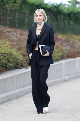 PARIS, FRANCE - SEPTEMBER 24:  Caroline Daur is seen on the street during Paris Fashion Week SS19 wearing Dior on September 24, 2018 in Paris, France.  (Photo by Matthew Sperzel/Getty Images)