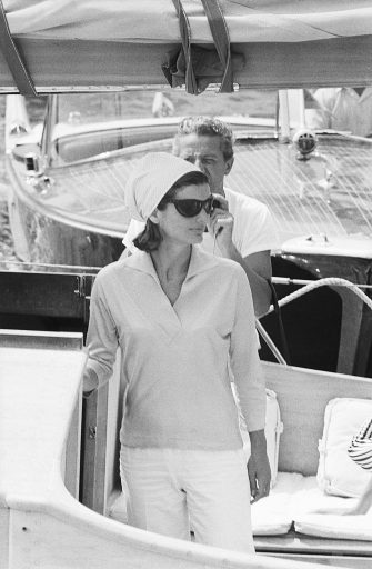 Jackie Kennedy is shown at the Pier of Amalfi, en route to Conca dei Marini beach via motorboat and then back from Amalfi to Ravello Villa.