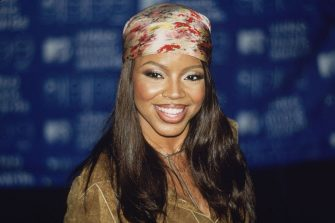 9th September 1999:  Pop star Shanice smiles at the camera, wearing a multi-colored bandana on her head at the MTV Video Music Awards at the Metropolitan Opera House at Lincoln Center, New York City.  (Photo by Karl Feile/Hulton Archive/Getty Images)