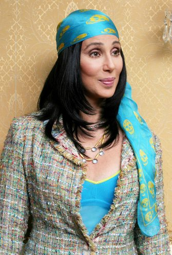 """NEW YORK  - NOVEMBER 22:  ***NO U.S. SALES FOR 90 DAYS***  ***U.S. TABLOIDS OUT***  Actress Cher poses at a press junket for her new film """"Stuck On You"""" at the Regency Hotel November 22, 2003 in New York, New York.  (Photo by Munawar Hosain/Getty Images)"""
