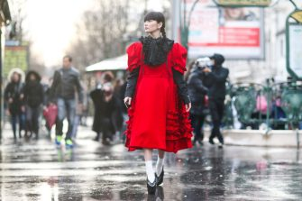 PARIS, FRANCE - MARCH 04:  Akimoto Kozue is wearing a black and red dress with ruffles, white socks, and black shoes, outside the Comme des Garcons show, during Paris Fashion Week Womenswear Fall/Winter 2017/2018, on March 4, 2017 in Paris, France.  (Photo by Edward Berthelot/Getty Images)