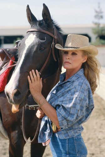 Swiss actress Ursula Andress with a horse, circa 1985. (Photo by Maureen Donaldson/Getty Images)