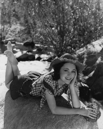 circa 1935:  Irish-born film star Maureen O'Sullivan relaxing in 'hillbilly' clothes. She starred in such films as 'Information Kid' (1932), several Tarzan pictures including 'Tarzan Escapes' (1936), 'Anna Karenina' (1935) and 'Hideout' (1934). She is the mother of actress Mia Farrow.  (Photo by Hulton Archive/Getty Images)