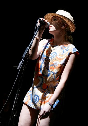 "INDIO, CA - APRIL 27:  Actress Scarlett Johansson sings with ""The Jesus And Mary Chain"" band during day 1 of the Coachella Music Festival held at the Empire Polo Field on April 27, 2007 in Indio, California.  (Photo by Kevin Winter/Getty Images)"
