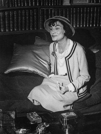 French fashion designer Coco Chanel (1883 - 1971) in her apartment at the Hotel Ritz Paris, 1960. (Photo by Agence France Presse/Archive Photos/Getty Images)