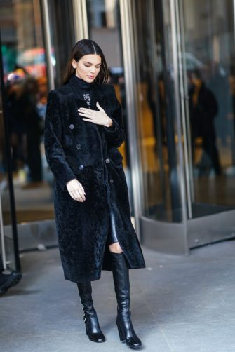 NEW YORK, NEW YORK - FEBRUARY 08: Kendall Jenner wears a turtleneck pullover, a black fluffy long coat, outside Longchamp, during New York Fashion Week Fall-Winter 2020, on February 08, 2020 in New York City. (Photo by Edward Berthelot/Getty Images)
