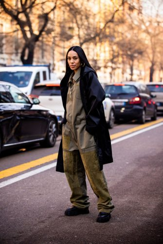 MILAN, ITALY - JANUARY 13:  Aleali May, wearing a khaki green jumpsuit, black coat and black shoes, is seen outside the Fendi show during the Milan Men's Fashion Week on January 13, 2020 in Milan, Italy. (Photo by Claudio Lavenia/Getty Images)