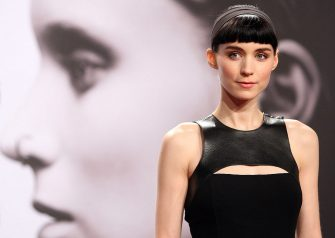 BERLIN, GERMANY - JANUARY 05:  Actress Rooney Mara arrives for the German premiere of the film 'The Girl With the Dragon Tattoo,' ('Verblendung') the first part of a series of film versions of the 'Millennium Trilogy,' based on books of the same name by Swedish author Stieg Larsson, on January 5, 2012 in Berlin, Germany. The film, about an investigative journalist aided in his search for a woman who has been missing for 40 years by a young computer hacker, will be released in German cinemas on January 12.  (Photo by Adam Berry/Getty Images)