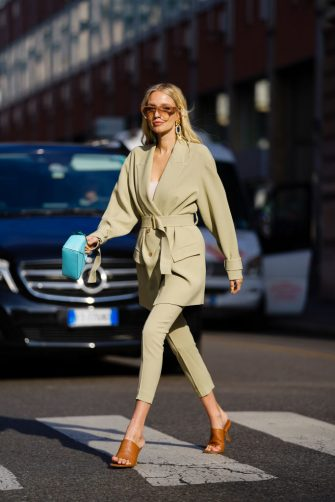 MILAN, ITALY - FEBRUARY 23: Leonie Hanne wears an oversized blazer beige jacket, a blue bag, cropped pants, brown sandals, outside BOSS, during Milan Fashion Week Fall/Winter 2020-2021 on February 23, 2020 in Milan, Italy. (Photo by Edward Berthelot/Getty Images)