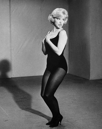 Marilyn Monroe rehearses a dance routine for the film Let's Make Love.
