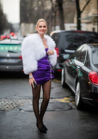 PARIS, FRANCE - JANUARY 22: Chiara Ferragni is seen wearing purple dress, white cropped jacket outside Alexandre Vauthier during Haute Couture Spring Summer 2019 : Day Two on January 22, 2019 in Paris, France. (Photo by Christian Vierig/Getty Images)