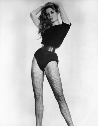 1959:  Studio portrait of French actor Brigitte Bardot wearing a black bodysuit cinched at the waist with a belt and black fishnet stockings in a promotional portrait for director Julien Duvivier's film, 'A Woman Like Satan'.  (Photo by Hulton Archive/Getty Images)
