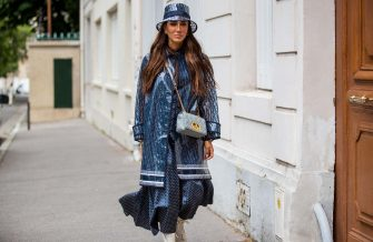 PARIS, FRANCE - JULY 05: Tamara Kalinic is seen wearing Dior rain coat, bucket hat, bag, dress, laced boots outside Dior on July 05, 2021 in Paris, France. (Photo by Christian Vierig/Getty Images)