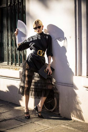 PARIS, FRANCE - JULY 03: Caroline Daur, wearing a black shirt, black tulle skirt, Valentino belt, Valentino bag and black Valentino heels, is seen outside VALENTINO show during Paris Fashion Week - Haute Couture Fall/Winter 2019/2020 on July 03, 2019 in Paris, France. (Photo by Claudio Lavenia/Getty Images)