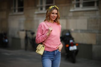 DUSSELDORF, GERMANY - MARCH 24: Scarlett Gartmann wearing pink Vogue sweater, Zara blue jeans, yellow H&M headband and yellow Chanel leather bag on March 24, 2021 in Dusseldorf, Germany. (Photo by Jeremy Moeller/Getty Images)