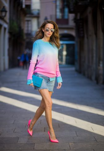 BARCELONA, SPAIN - NOVEMBER 28: Alexandra Lapp wearing mini jeans skirt from Levis, batik cashmere pullover from Heartbreaker in turquoise and pink, Jadicted silk blouse in turquoise, little purse bag from Chanel with golden Chanel sign, silver mirrored sunglasses from Le Specs and pink patent So Kate heels from Christian Louboutin on November 28, 2017 in Barcelona, Spain. (Photo by Christian Vierig/Getty Images)