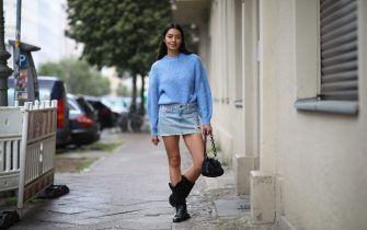 BERLIN, GERMANY - MAY 05: Alyssa Cordes wearing Levis jeans skirt, blue sweater, vintage cowboy boots and Fabienne Chapot bag on May 05, 2020 in Berlin, Germany. (Photo by Jeremy Moeller/Getty Images)