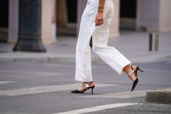 PARIS, FRANCE - MAY 14: A passerby wears white jeans, bejeweled pointy shoes, in the streets of Paris, on May 14, 2020 in Paris, France. (Photo by Edward Berthelot/Getty Images)
