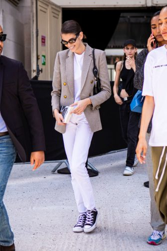 PARIS, FRANCE - JULY 02:  Kaia Gerber, wearing a white t-shirt, white jeans, checked blazer, black bag, Chanel sunglasses and black Converse, is seen outside Chanel show during Paris Fashion Week - Haute Couture Fall/Winter 2019/2020 on July 02, 2019 in Paris, France. (Photo by Claudio Lavenia/Getty Images)