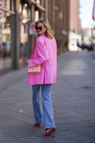 BERLIN, GERMANY - APRIL 27: Mandy Bork wearing pink Amina Muaddi heels, Zara destroyed blue jeans, rose Bulgari bag, Bottega Veneta shades and pink Storets blazer on April 27, 2021 in Berlin, Germany. (Photo by Jeremy Moeller/Getty Images)