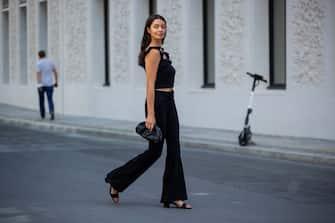 BERLIN, GERMANY - JUNE 14: Alyssa Cordes is seen wearing black flared pants, black top, bag, sandals total look Liu Jo on June 14, 2021 in Berlin, Germany. (Photo by Christian Vierig/Getty Images)