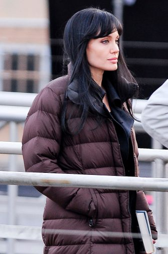 """NEW YORK - DECEMBER 30:  Actress Angelina Jolie walks to the """"Salt"""" film set at Pier 66 on December 30, 2009 in New York City.  (Photo by Ray Tamarra/Getty Images)"""